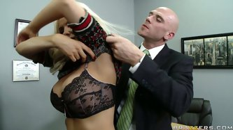 Diamond Foxxx is a hot blonde teacher. She is wearing too short dress and making horny her students. The principle wants to punish her, but gets seduc