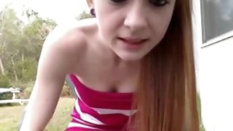 Cute redhead teen girl plays in backyard. She chats with her friend and her asks her to show her pussy. She takes off her panties and shows her cunt.