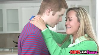 Horny mom watches how a young boy eats the teen pussy of a blonde cutie. She also wants to get her pussy licked by this guy!