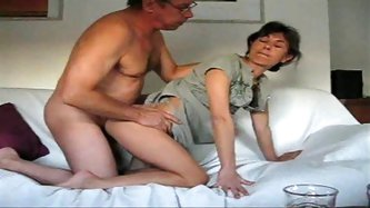 Brunette milf gets gets doggy fucked by old fat cock. She rides on his dick in hardcore amateur homemade video.