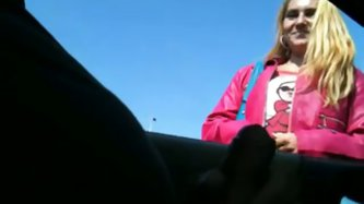 Street hooker gives me an amazing hand job through the window of the car. She rubs it hard in public like a good amateur slut. I cum over her hand and